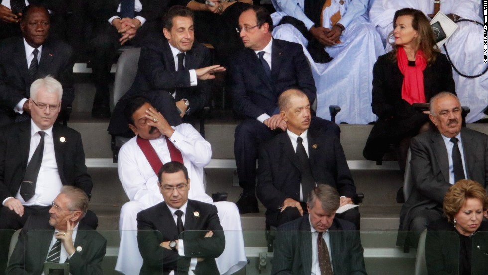 World leaders, including former French President Nicolas Sarkozy, top second left, and French President Francois Hollande, top second right, attend the memorial service.