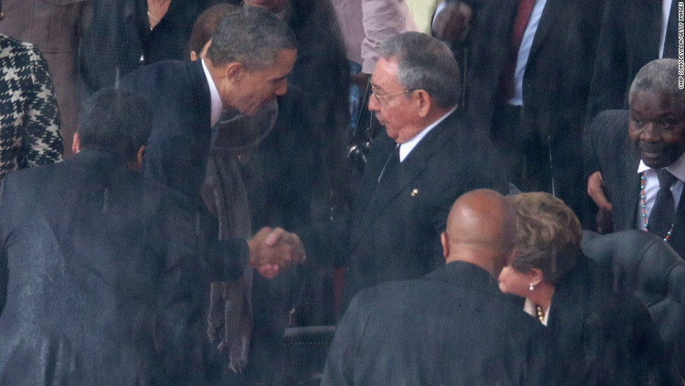 Obama shakes hands with Cuban President Raul Castro just before speaking.