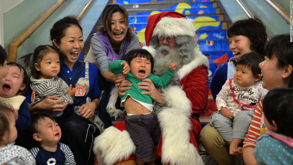 A man playing Santa Claus entertains children at a nursery school in Tokyo on December 9.
