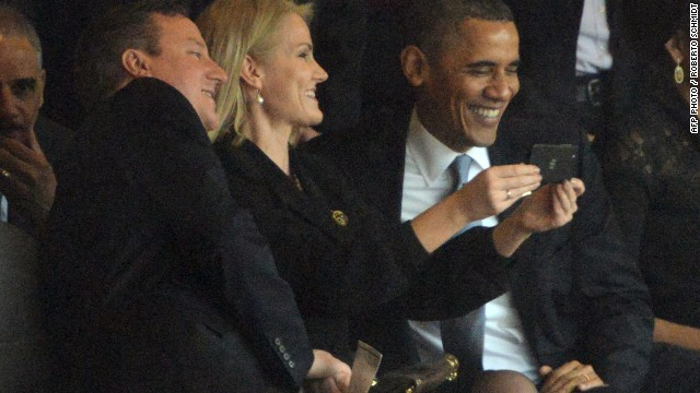 The three world leaders share a photo at Mandela's memorial.