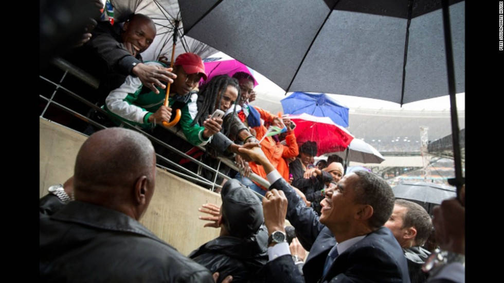 President Obama greets South Africans as he leaves the stadium