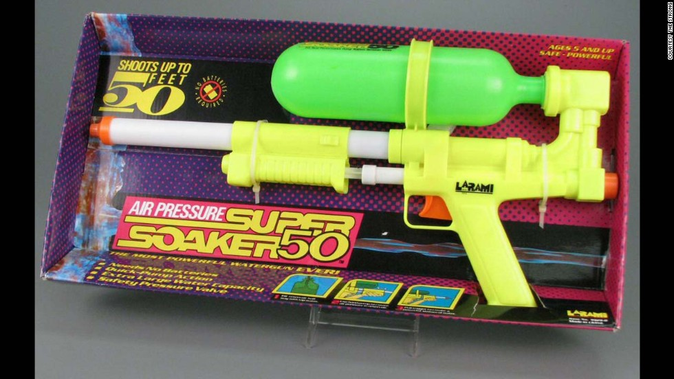 "Super Soaker 50 water pistol by Larami Corp. in 1990. The year was 1989: Children were still throwing around archaic water balloons until Lonnie Johnson, a nuclear engineer, came up with the idea of a high-powered toy water gun. It was originally called the ""Power Drencher,"" and Johnson started a whole new era of backyard water fights. The Super Soaker 50 didn't require batteries and was one of the most powerful water guns on the market."