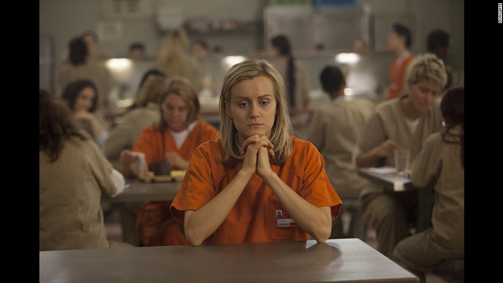 "Nominadas a mejor actriz de serie de TV - drama: Taylor Schilling en ""Orange Is the New Black"" (foto), Julianna Marguiles en ""The Good Wife,"" Tatiana Maslany en ""Orphan Black,"" Kerry Washington en ""Scandal"" y Robin Wright en ""House of Cards."""