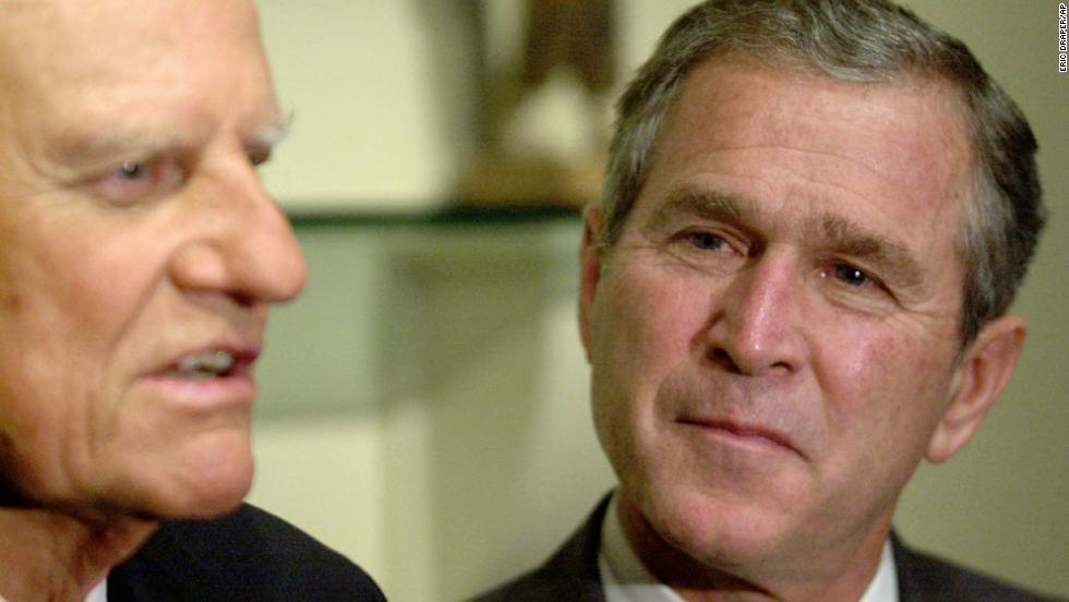 Presidential candidate George W. Bush meets with Graham in Jacksonville, Florida, on November 5, 2000. Years earlier, Bush said, a conversation with Graham had helped lead him to give up drinking.