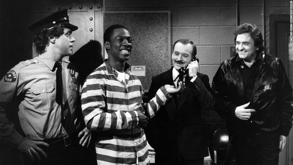 "Joe Piscopo, from left, Eddie Murphy, Brian Doyle-Murray, and Johnny Cash perform a ""Saturday Night Live"" skit on April 17, 1982."