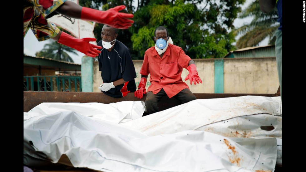 The bodies of 16 Muslim men are loaded onto a truck at the Nour Islam Mosque before being transported for burial in Bangui on Wednesday, December 11.