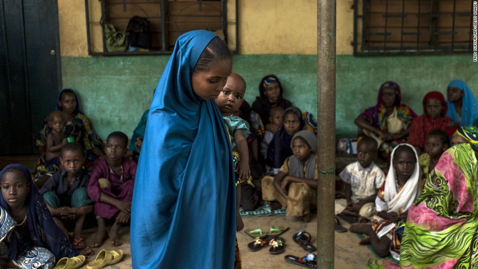 A young woman holds her baby at an elementary school in the Muslim district of Bangui on December 11.