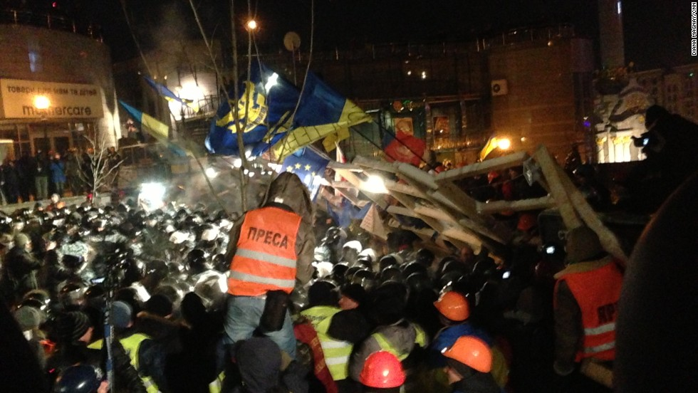 KIEV, UKRAINE:  Ukrainian riot police storm barricades set up by pro-European Union protesters in Independence Square on December 11. Ukrainian security forces stormed the square, which protesters have occupied for three weeks. The demonstrators defiantly refused to leave and resisted the police in a tense standoff.  Photo by CNN's Diana Magnay.