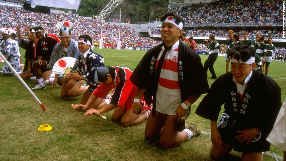 It's not always the fans who enforce the fancy dress code. In this image, Japanese players salute the crowd at the Hong Kong Rugby Sevens in 1990.