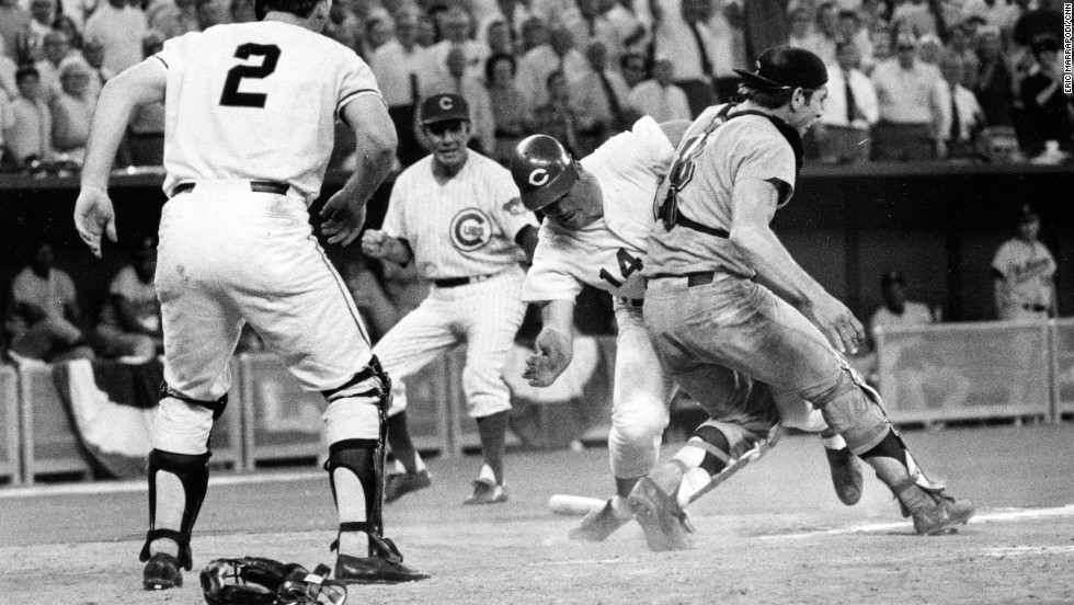 Cincinnati Reds' Pete Rose slams into Cleveland Indians' catcher Ray Fosse to score a controversial game-winning run for the National League team in the 12th inning of the 1970 All-Star game in Cincinnati. Fosse suffered a fractured shoulder in the collision.