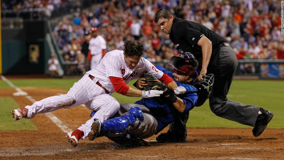 Chase Utley of the Philadelphia Phillies collides with Dioner Navarro of the Chicago Cubs on August 7 in Philadelphia.