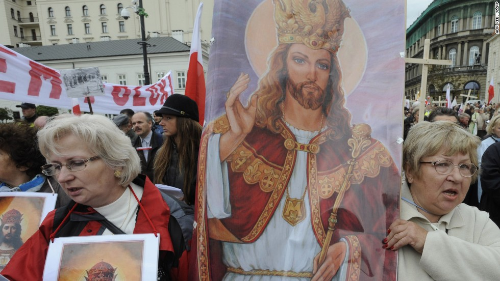 Women carry a religious painting as hundreds of Roman Catholics march through Warsaw's downtown demanding more religion in social and political life in Poland on September 19, 2010.