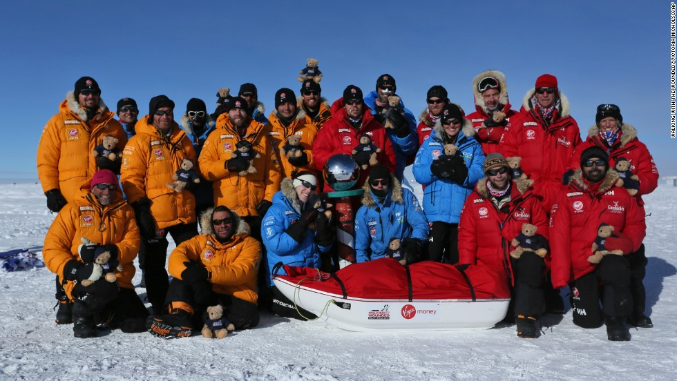 Prince Harry, back row fourth right, with members of Team UK, Team Commonwealth and Team U.S. at the South Pole as part of the Virgin Money South Pole Allied Challenge 2013 on December 13.