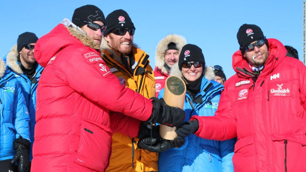 Prince Harry, left, with fellow adventurers after reaching the South Pole.
