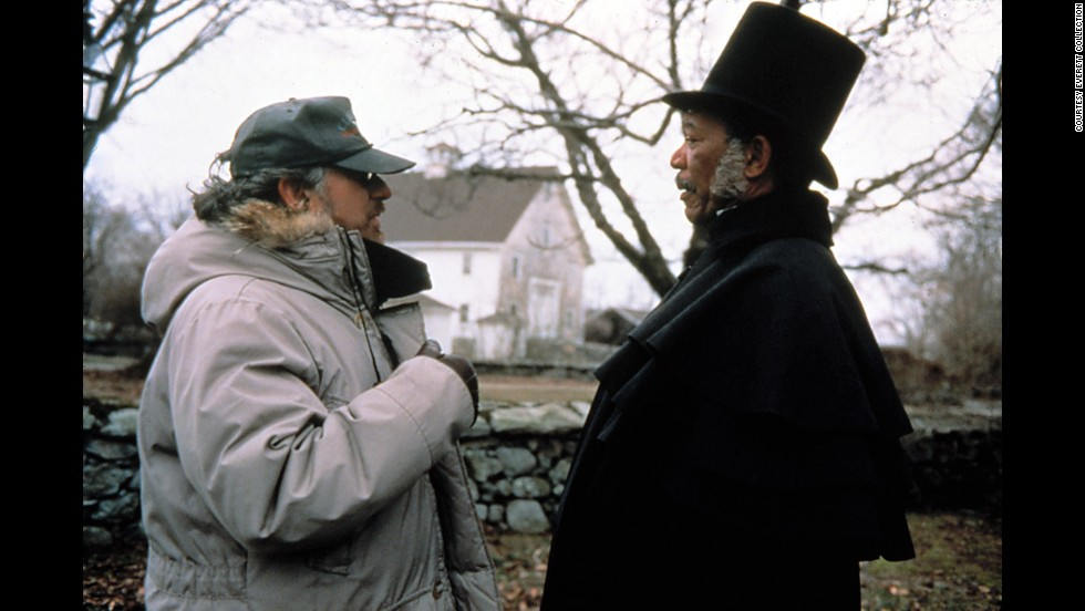 "Spielberg appears on the set of the 1997 film ""Amistad"" with actor Morgan Freeman."