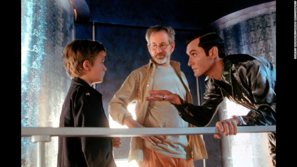 "Actor Haley Joel Osment, left, Spielberg and Jude Law work on a scene from the movie ""A.I. Artificial Intelligence"" in 2001. The film is about a highly advanced robotic boy longing to become ""real,"" a real sci-fi ""Pinocchio"" drama."