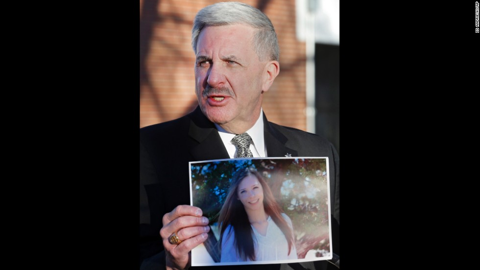 Arapahoe County Sheriff Grayson Robinson holds a picture of Davis at a press conference on Saturday, December 14, after identifying her as the victim of the shooting at Arapahoe High School the day before.