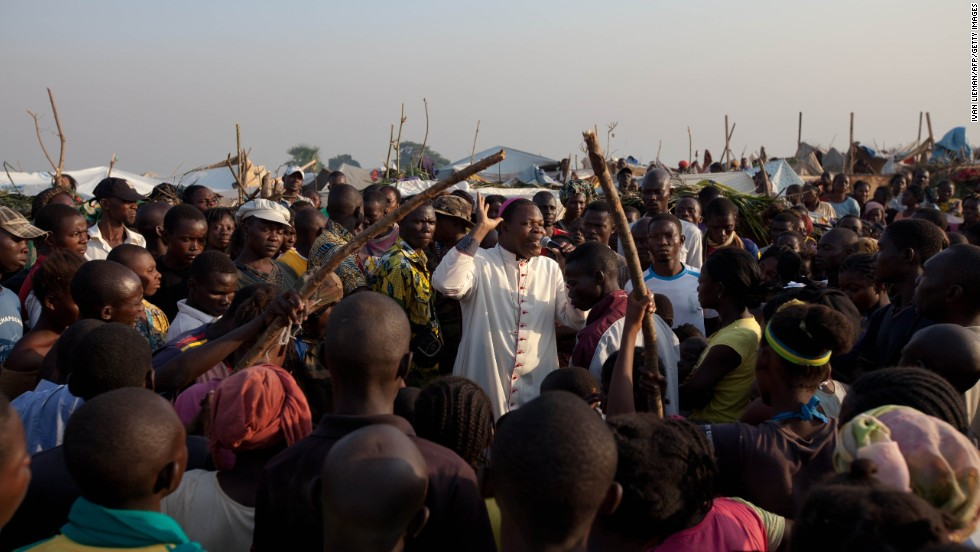 The Archbishop of Bangui, Dieu Donne Nzapa Lainga, preaches on Saturday, December 14, to people gathering at a refugee camp close to the Bangui airport.