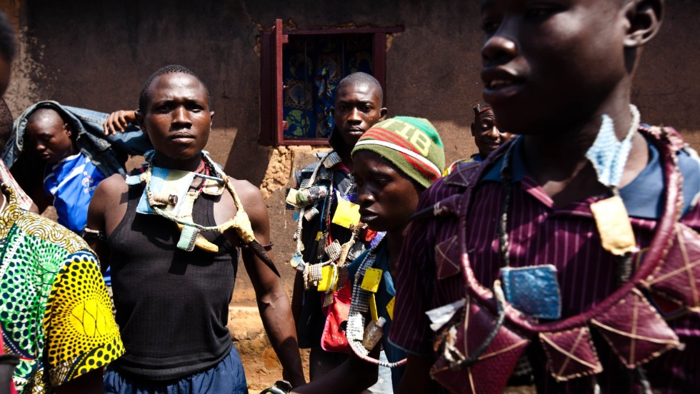 Members of a militia opposed to the Seleka pose with weapons and amulets in the Boy-Rabe neighborhood in Bangui on December 14.