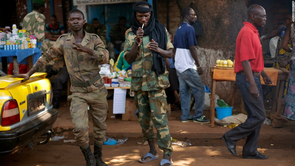 A Seleka presidential guardsman smokes at the downtown market in Bangui on December 14.