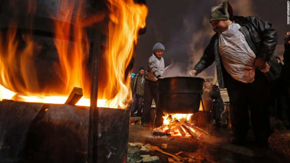 Pro-EU activists cook during a rally in Independence Square on Sunday, December 15.