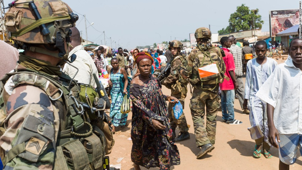 French troops patrol a street of the Muslim PK-5 district in Bangui on December 16.