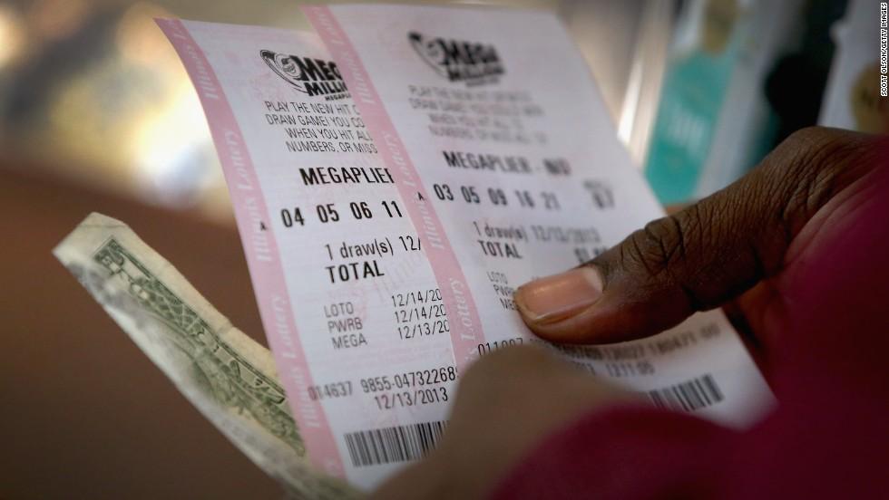 Georgia woman claims half of $648 million Mega Millions jackpot