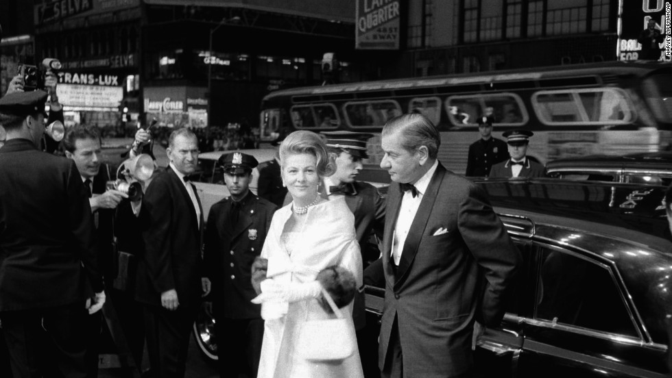 "Fontaine, escorted by Charles Addams, arrives at the Rivoli Theater in 1963 for the world premiere of the film ""Cleopatra"" in New York."