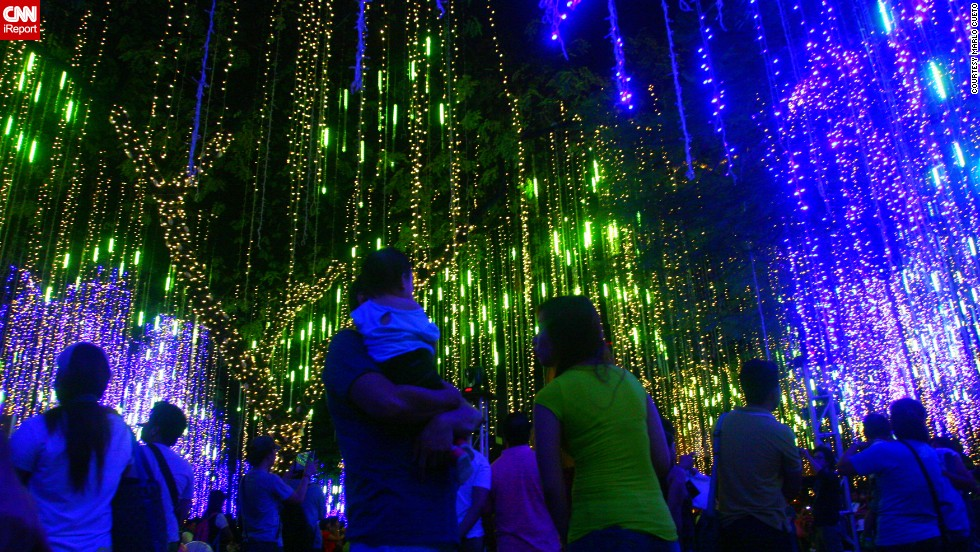 "<a href=""http://ireport.cnn.com/docs/DOC-1066982"" target=""_blank"">Marlo Cueto </a>photographed an annual lights and sound show in the Philippines. ""With thousands of lights dangling from the trees of Ayala Triangle Gardens, people enjoyed watching the show as the lights of variety of colors dance to the tune of Christmas medley,"" he says.This year's show is dedicated to the victims of the recent typhoon."