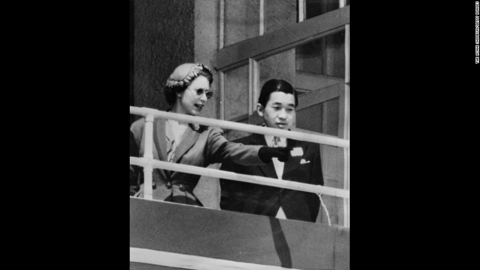 Queen Elizabeth II and Akihito are seen in the royal box at the Epsom Downs Racecourse on June 6, 1953, in England. Crown Prince Akihito made the trip to attend her coronation.