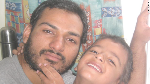 Abbas Khan, pictured with his son Abdullah, had volunteered to treat wounded victims.