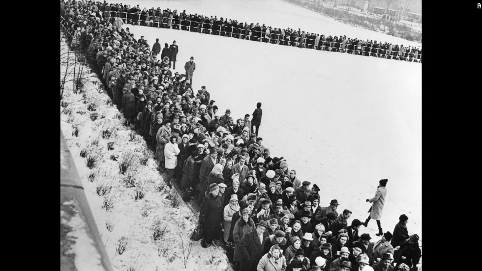 Thousands of people line up December 19, 1963, to apply for passage into East Berlin. An estimated 2 million residents of West Berlin applied for holiday passes to East Berlin, and about half were able to receive one.