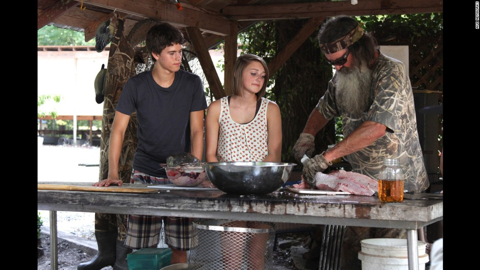 "Phil Robertson cuts meat during a recent ""Duck Dynasty"" episode. He was <a href=""http://www.cnn.com/2013/12/19/showbiz/duck-dynasty-suspension/index.html"">suspended by A&E</a> in December 2013 after he made controversial remarks about gays and blacks in an interview with GQ magazine."