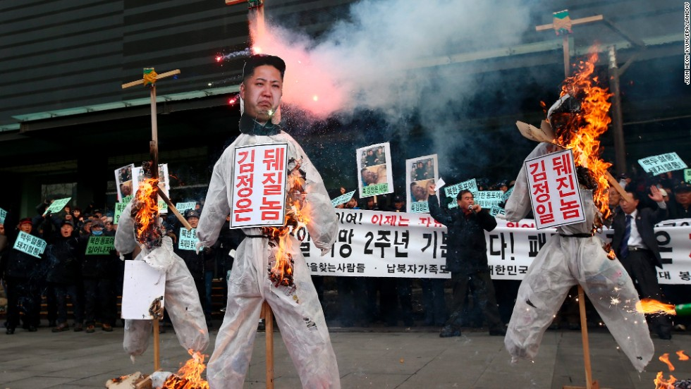 "Conservative protesters in Seoul, South Korea, burn effigies of North Korean leader Kim Jong Un and former North Korean leaders Kim Jong Il and Kim Il Sung during a rally Tuesday, December 17. In response to protests in Seoul, North Korea sent a fax to South Korea threatening to ""strike mercilessly without notice"" for what it called ""provocation against our highest dignity."""