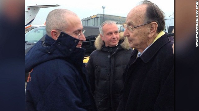 This handout photo released by KHODORKOVSKY RU website shows Russian former oil tycoon and Kremlin critic Mikhail Khodorkovsky (L) shaking hands with former German foreign minister Hans-Dietrich upon arrival at Schoenefeld airport in Berlin on December 20, 2013. Khodorkovsky walked out of jail after more than 10 years behind bars, immediately flying to Germany following his surprise pardon by President Vladimir Putin. AFP PHOTO / KHODORKOVSKY RU-/AFP/Getty Images