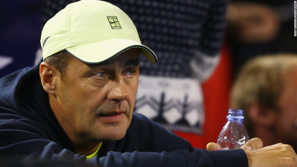 Tomic's father and coach John, pictured, received an eight-month suspended sentence in September after he head-butted the player's former hitting partner Thomas Drouet. He has been banned from attending tournaments.
