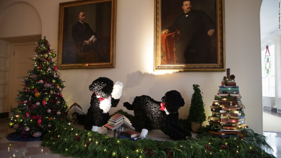Replicas of the first dogs, Bo, left, and Sunny, right, are featured in the holiday decorations in the East Garden Room of the White House on December 4.