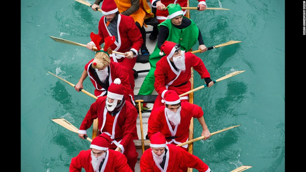 Rowers dressed in Santa Claus costumes take part in the Christmas Regatta on the Grand Canal on Saturday, December 21, in Venice, Italy.