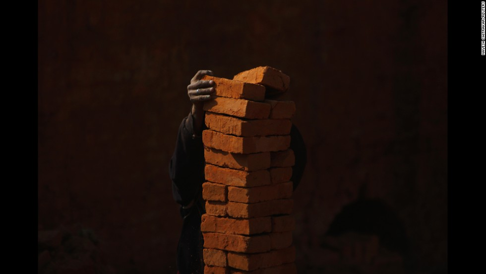 <strong>December 20: </strong>A man stacks bricks at a brick factory in Lalitpur, Nepal.