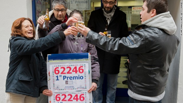 "Lottery Administration owners and locals celebrate having sold a first prize ticket in Spain's Christmas lottery named ""El Gordo"" (Fat One) in Palencia on December 22, 2013."
