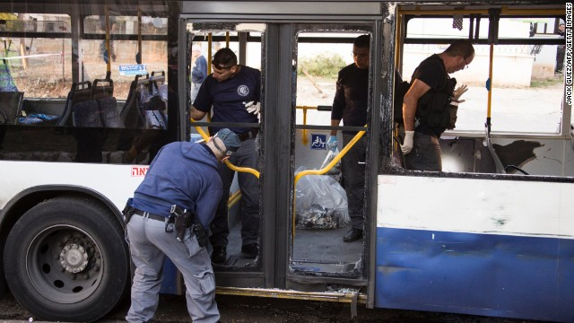 Police officers inspect the scene of an explosion inside a bus on December 22 in Israel.