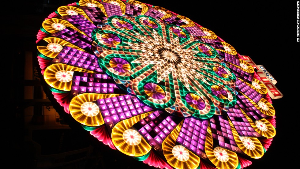 "DECEMBER 24 - SAN FERNANDO, PHILIPPINES: <a href=""http://cnn.com/2013/12/23/travel/san-fernando-philippines-christmas/index.html"">San Fernando is dubbed ""Christmas Capital of the Philippines</a>"" for its Giant Lantern Festival.  A giant parol -- Christmas lantern -- costs around US$11,300-15,820 to build and rises 20 feet into the air."