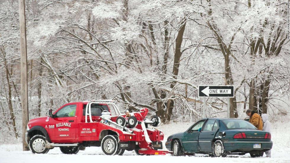 A tow truck prepares to pull a vehicle from a crash scene in Muskegon, Michigan, on December 22.
