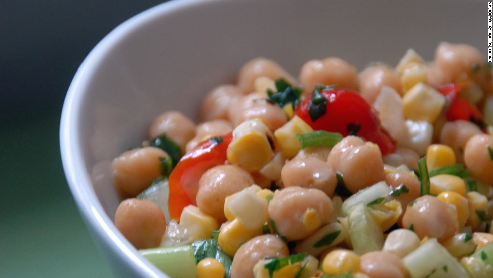"Whether you call them garbanzos or chickpeas, a half-cup serving of these hearty legumes provides about 40% of your daily protein needs and 70% of your daily fiber intake, helping to stabilize blood sugar, <a href=""http://www.health.com/health/gallery/0,,20435321,00.html"" target=""_blank"">control cravings</a> and prevent overeating, Gidus says. <br /><br />They're also a great source of healthy unsaturated fats that can whittle your waistline. A 2009 study from the University of Newcastle in Australia found that participants who consumed the most unsaturated fats had lower body mass indexes and less belly fat than those who consumed the least.<br /><br /><a href=""http://www.health.com/health/recipe/0,,50400000113216,00.html"" target=""_blank"">Try this recipe: Cumin-spiced chickpeas</a>"