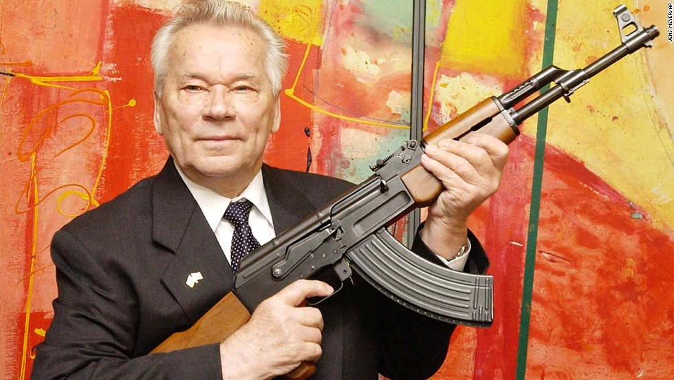 Russian weapons designer Mikhail Kalashnikov presents his legendary assault rifle, the AK-47, to the media while opening an exhibition of his work at a weapons museum in Suhl, Germany, in 2002. Kalashnikov died on December 23 at the age of 94. Click through to see where else in the world the AK-47 has appeared.