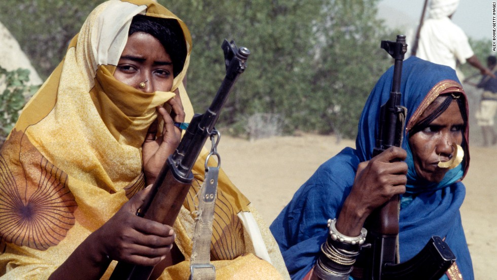 Fighters with the Eritrean People's Liberation Front sit with their rifles in 1978.