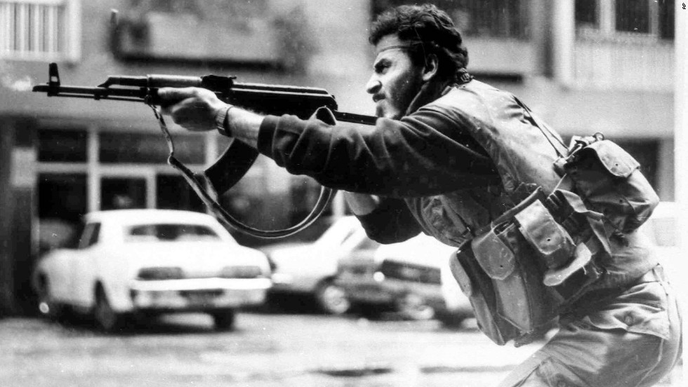 A Shiite Muslim militiaman fires his AK-47 during a battle in West Beirut, Lebanon, in 1987.