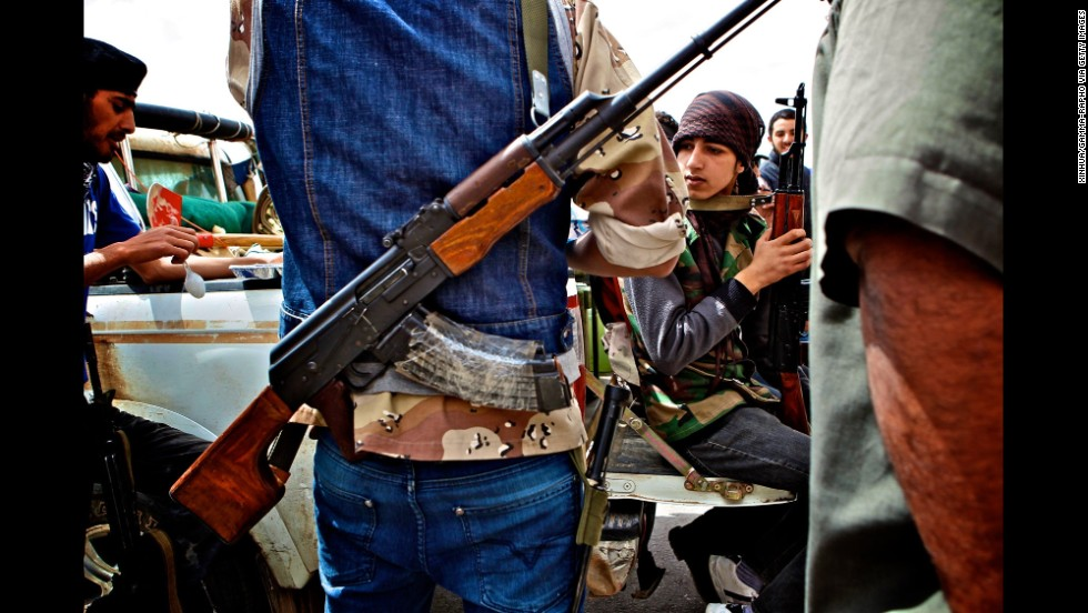 Anti-Libyan-government militants gather on the front line in Brega, Libya, in 2011.