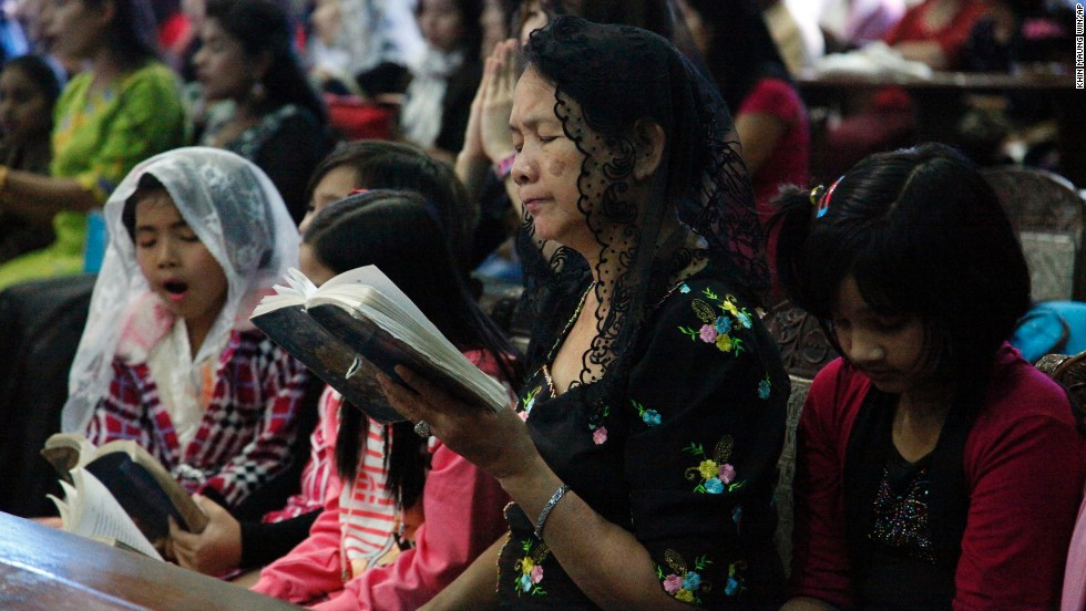 People pray during a Christmas Mass in Yangon, Myanmar.