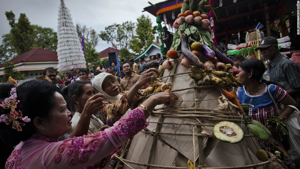 People search for vegetables as part of a popular ritual during Christmas celebrations in Klaten, Indonesia.